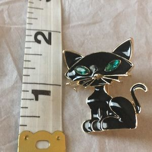 Gold tone black cat brooch with green Jeweled eyes